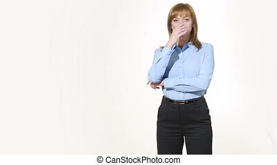 insincere gesture. mouth is closed with one hand. girl in...