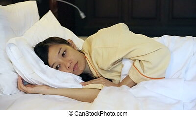 insomnia worried asian woman in bed