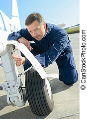 inspecting a small aircraft