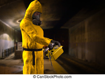 Inspecting Air Quality - Person dressed in yelow Hazardous...