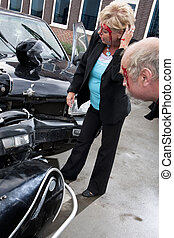 Inspecting damage - Two wounded people, bleeding, examining...
