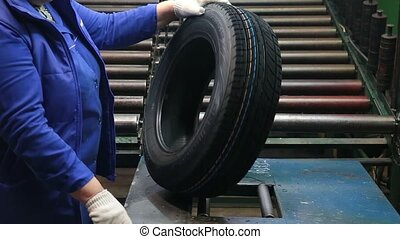 Inspection and quality control at a tire factory. - Tires...