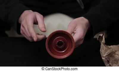 inspection of a ceramic shisha cup.