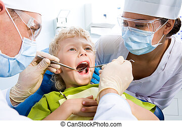 Inspection of oral cavity - Dental inspection is being given...