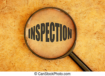 Inspection - Magnifying glass focusing on the word...