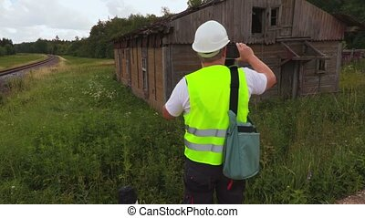 Inspector checking abandoned building