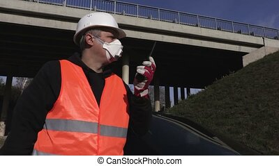 Inspector in the air mask at bridge is closing traffic