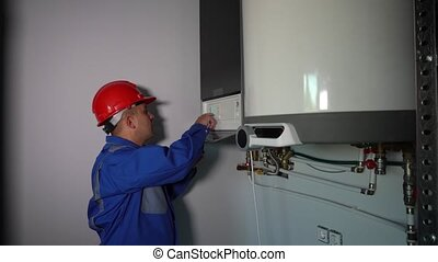 Inspector man checking heating system for problems and shout...