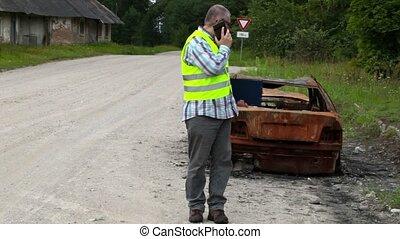 Inspector walking near the car wrec