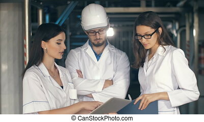 Inspectors working at the plant