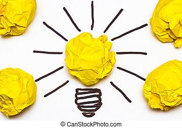 Inspiration concept crumpled paper light bulb metaphor