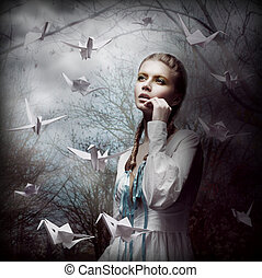 Inspiration. Woman with Flying White Origami Swans in Dark...
