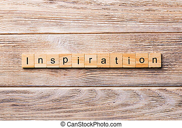 Inspiration word written on wood block. Inspiration text on wooden table for your desing, concept