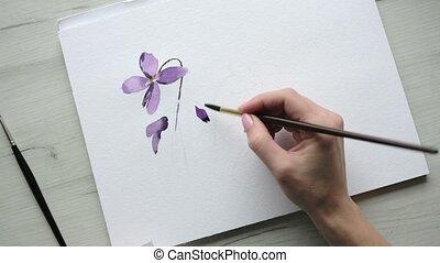 Inspirational female artist painting purple flower - ...