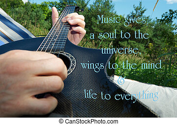 Inspirational quote on music by Plato, with a man's hand...