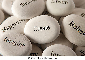 Inspirational stones - Create - Close up of engraved stones