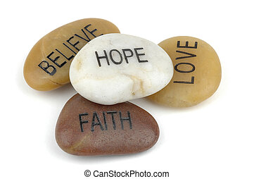 Pile of stones carved with inspirational words.