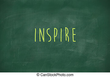 Inspire handwritten on blackboard - Inspire handwritten on...