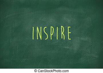 Inspire handwritten on blackboard - Inspire handwritten on...