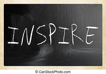 """Inspire"" handwritten with white chalk on a blackboard"