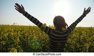 Inspired blonde woman jumping with raised hands in a huge...