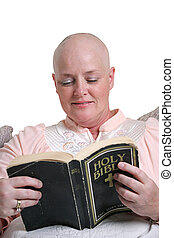 A medical patient reading the bible for inspiration.