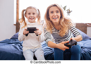 Inspired little girl playing with her mummy