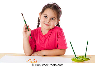 Inspired little girl with paintbrush