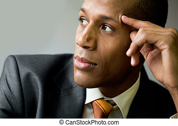 Inspired man - Pensive employee thinking of new ideas and...