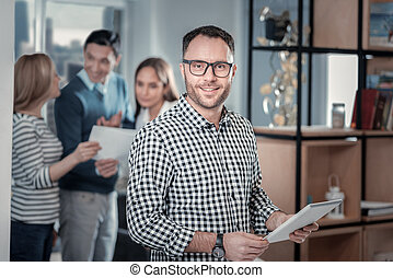 Inspired man standing with his tablet