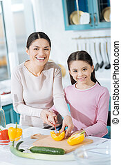Inspired mother making a salad with her daughter