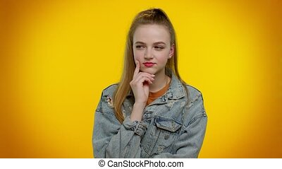 Eureka. Thoughtful clever inspired teen stylish girl make gesture raises finger came up with creative plan feels excited with good idea, inspiration motivation. Young woman on yellow studio background