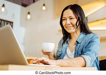 Inspired woman holding a cup of tea