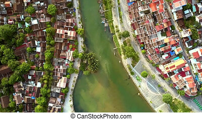 green river washes ancient Hoian embankments - inspiring...