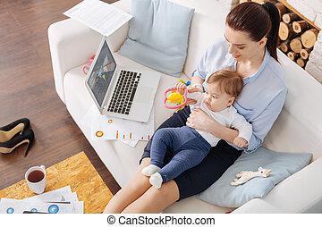 Inspiring working mother dedicating her time to daughter