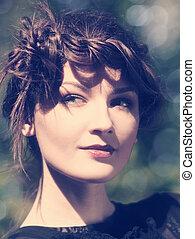 Instagram colorized vintage female portrait with beauty bokeh