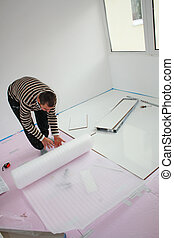 Workers laid laminate in home renovation