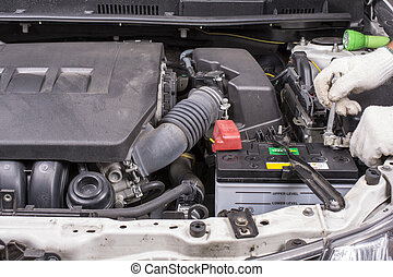 Install the car battery - Install the new car battery for...