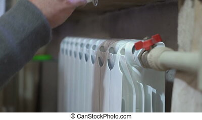 Installation and connection of new hot water radiator by a...