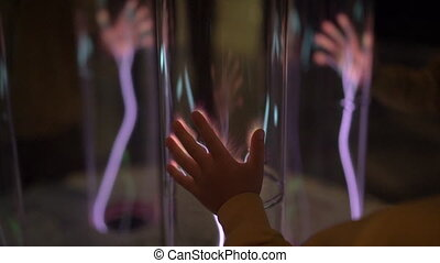 Installation in a science museum. Slowmotion shot of a hand...