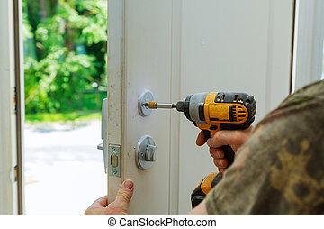 Installation locked interior door knobs, close-up woodworker...