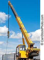 Installation of a fence by a mobile crane
