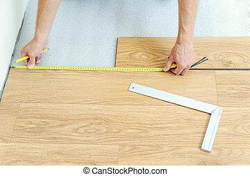 Installation of a laminate floorboard.