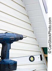 Installation of a siding on a house against