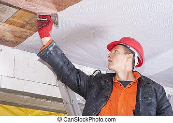 installation of a vapor barrier - builder attaches vapor...