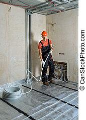 Installation of a warm floor.