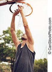 Installation Of Basketball Net On The Hoop
