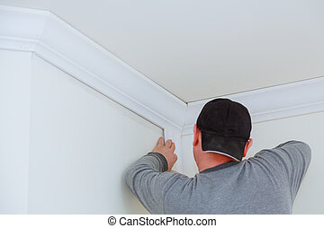 Installation of ceiling detail of corner crown molding