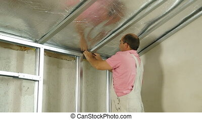 Installation of gypsum plasterboard ceilings, Medium shot