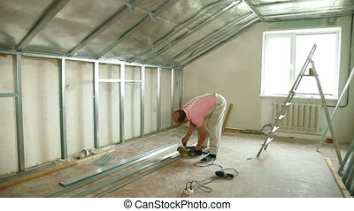 Installation of gypsum plasterboard ceilings - cutting...